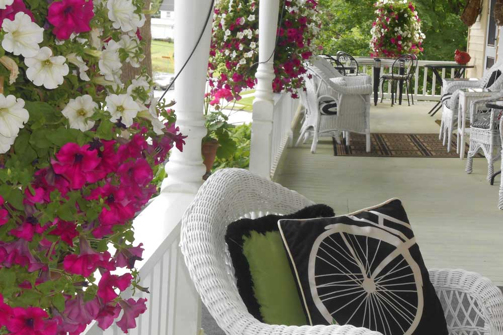 Wraparound porch with wicker furniture
