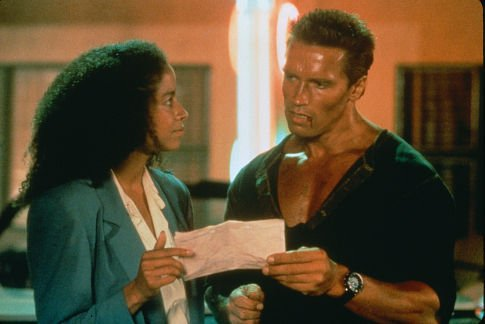 Rae Dawn Chong and Arnold Schwarzenegger