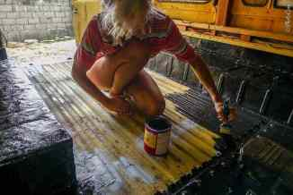 Karin-Marijke painting a rust protective layer.