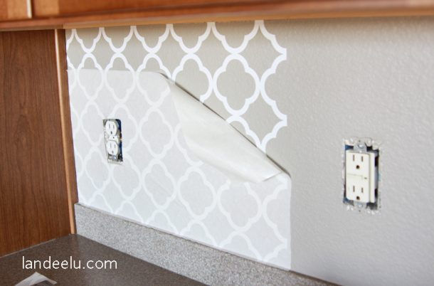 Easy vinyl backsplash for the kitchen! There\'s a video on how to apply it  too