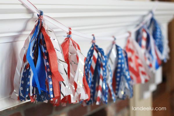 4th of July Tissue Paper Tassel Garland Idea from landeelu.com