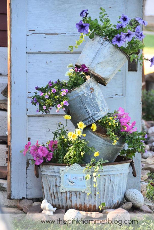 Tipsy pot planter tutorial by the pink hammer blog roundup for landeelu dot com