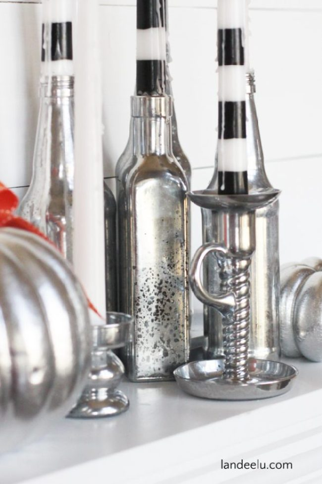 DIY Mercury Glass Halloween Candles   landeelu.com   Upcycle some old bottles and glassware into  glitzy Halloween candle holders!  Love the striped candles too!
