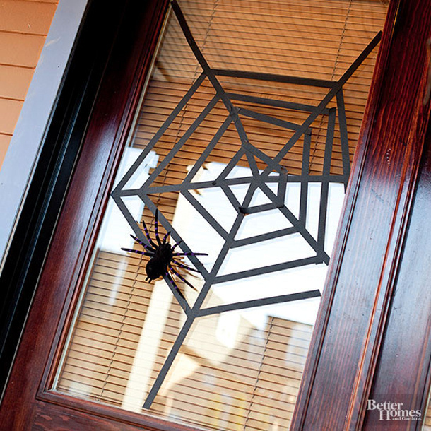 Almost FREE idea - use black tape to Web your glass door via BHG