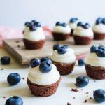 Brownies with cream cheese frosting and blueberries.... yum!!