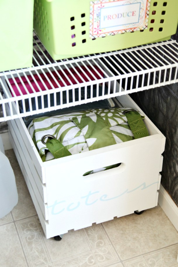 Make some cute DIY rolling crates to store pantry items on the floor under the shelves! | Tutorial via i heart organizing