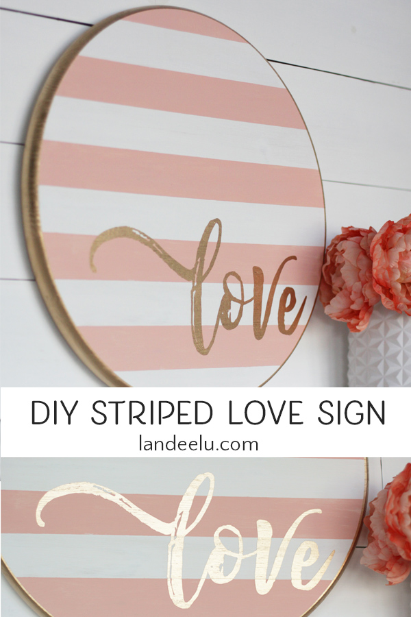 Grab a wood round from your local DIY store and make this darling striped Valentine's Day craft... a painted wood sign! #valentinesdaysign #valentinesdaycraft #valentinesday #DIYwoodsign #stencil
