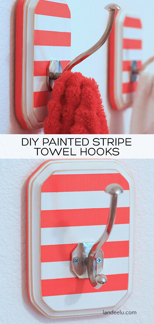 Easy way to customize a bathroom space simply by painting them! Try these fun DIY towel hooks to add some fun to any space! #bathroom #diydecor #towelhooks #stripes