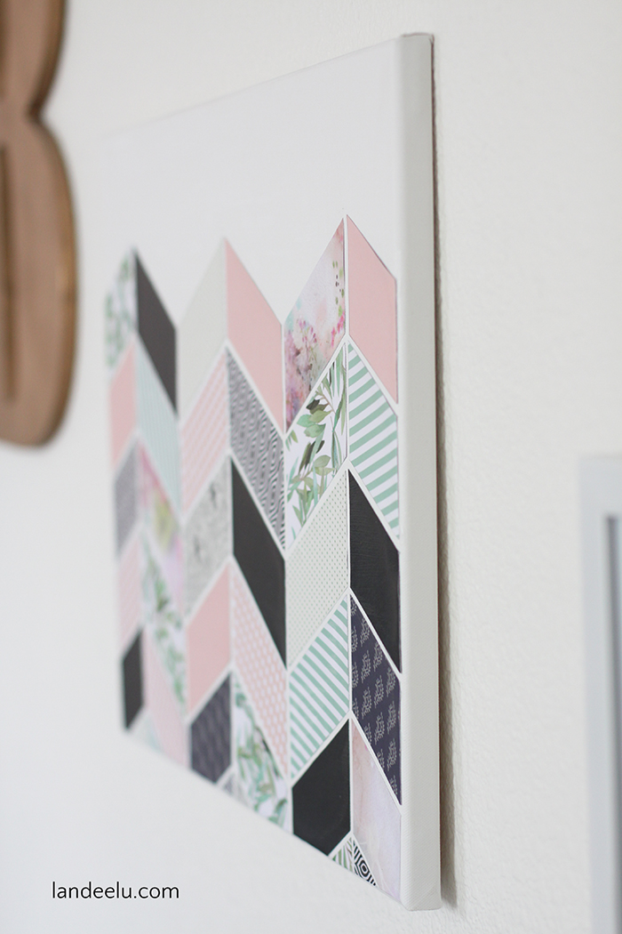 Create this cute DIY wall decor using decorative papers, a blank canvas and mod podge!