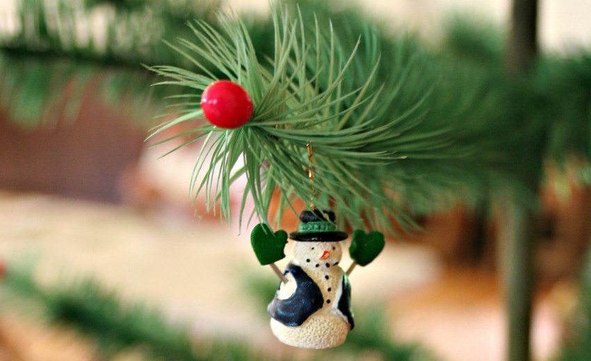 snowman ornament on feather tree