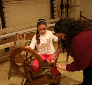 girl spinning wool