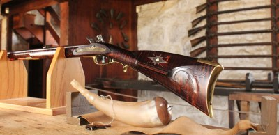 Long Rifle with Powder Horn for Auction