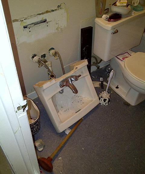 Sink torn off the bathroom wall