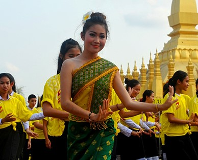 Woman dancing the Lam Vong dance - or circle dance