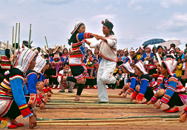 A man and woman dancing the bamboo dance