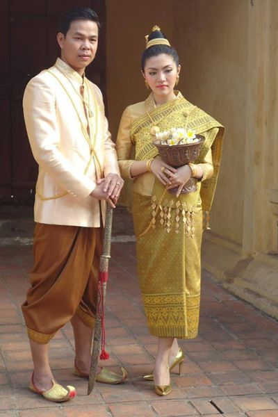 A man and woman dressed in traditional clothes