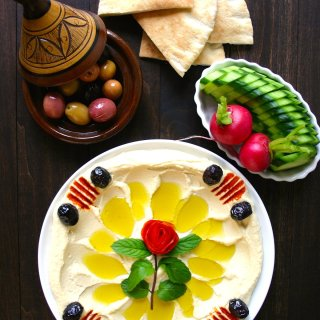 A simple recipe for an authentic, basic Hummus. Creamy and satisfying, this hummus is perfect as an anytime snack and also makes great party food.