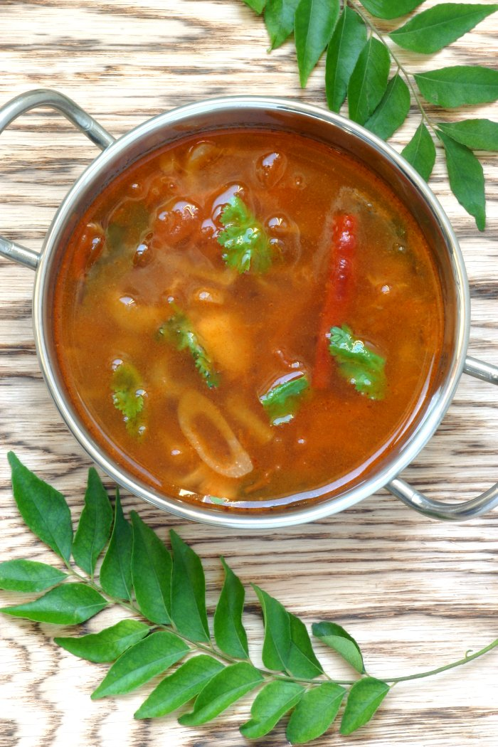 Hot, spicy, and tangy, Tomato Rasam is a quintessential South Indian dish featuring spices, chiles, and tamarind. Serve it as a soup or with rice.