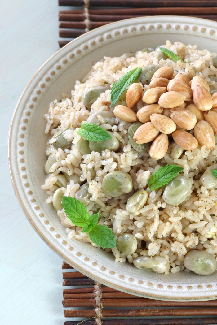 A springtime Fava Bean Rice Pilaf featuring creamy favas, authentic spices, and toasted almonds—and done in only 30 minutes!