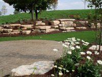 Backyard stone outcropping & garden | Landscape Gal