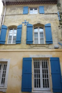Blue shutters with typical Arles coloring