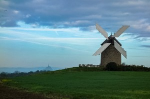 Local working mill with Mont Saint Michel in the background