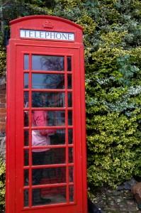 Niece Neela using the phone booth