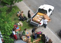 people packing truck