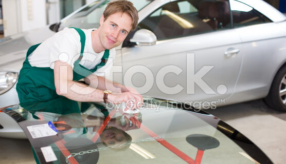 stock-photo-24145333-glazier-with-car-windshield-made-of-glass