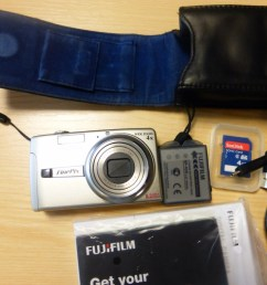 basic digital camera will do film as well can be downloaded to a computer using usb cable 4gig sdcard battery charger leather case manual software [ 1024 x 768 Pixel ]