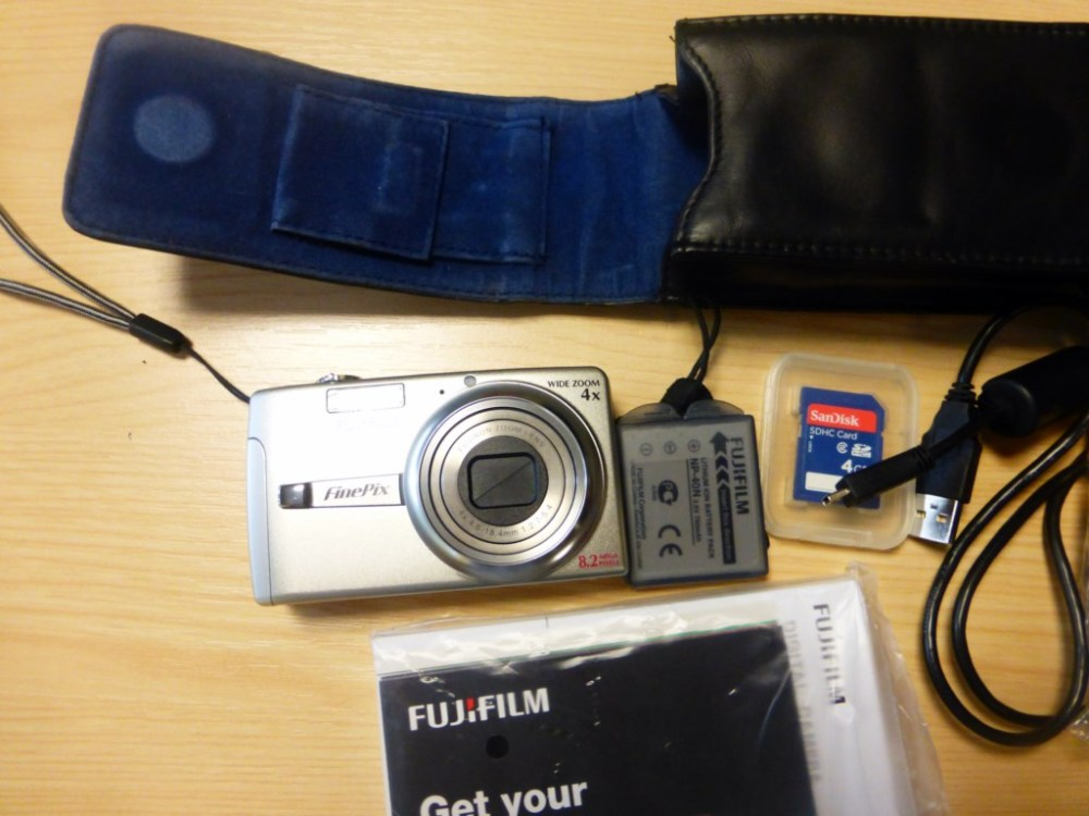medium resolution of basic digital camera will do film as well can be downloaded to a computer using usb cable 4gig sdcard battery charger leather case manual software