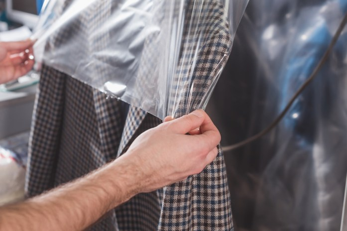 Men's suit hanging in a dry cleaner