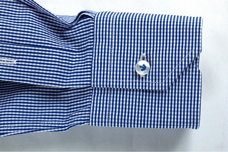 Mitered cuff of a tailor-made white men's blue checkered shirt
