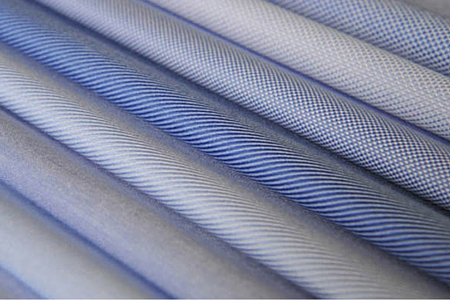 A series of blue fabrics for men's made to measure dress shirt, different varieties