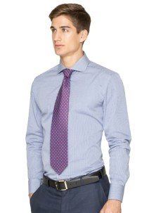 man with a custom light blue dress shirt and purple tie