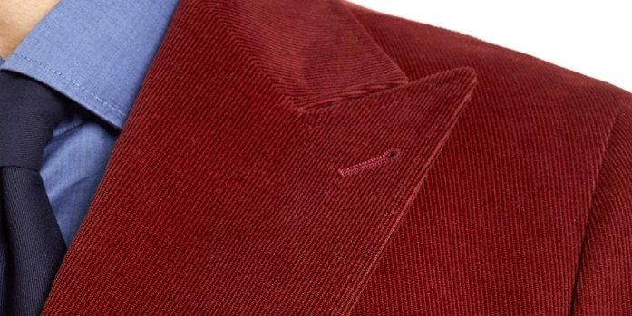 Wide pointed lapel on jacket in red velvet ribbed