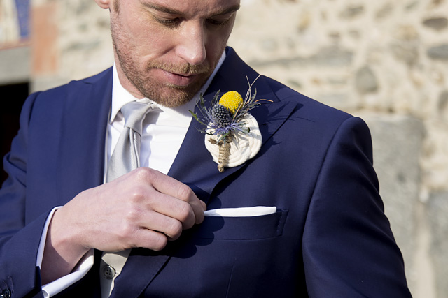 Man wears wedding jacket, boutonniere and pocket square Lanieri