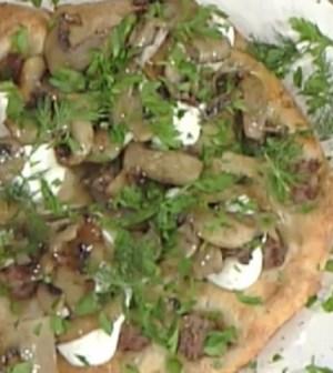 Foto pizza funghi e salsiccia La prova del cuoco