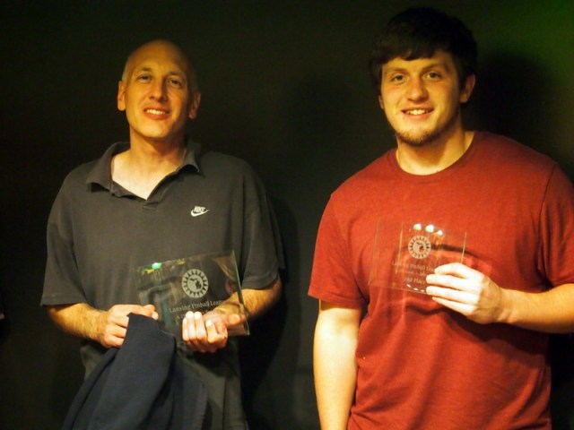 Chris and Alex with their trophies.