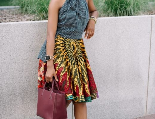 Crushing hard on her sunglasses! Love how this super cute UV polarized sunnies fits her face shape. Need her fit and flare African print dress too! African prints | Nigerian fashion | African fashion | African print clothes | ankara jackets | Dashiki Dress | African clothing | Dashiki skirt | African print styles | African print dress | African attire | Xperio UV lenses | Ray Ban | sunglasses
