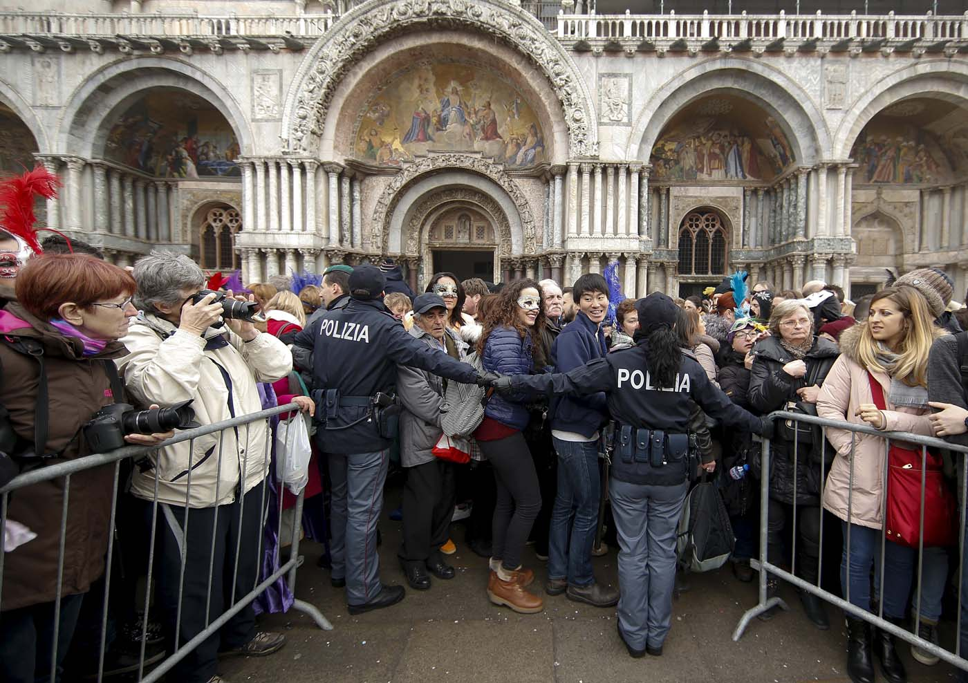 Italian policemen patrol as tourists arrive at San Marco Piazza during the Venice Carnival, January 31, 2016. REUTERS/Alessandro Bianchi