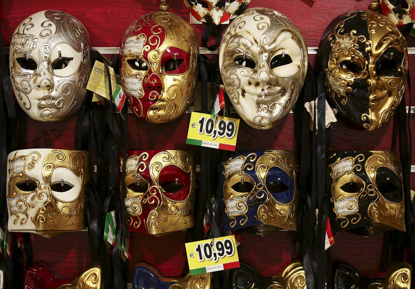 Carnival masks hang on the wall of the shop near St. Mark's Square during the Venice Carnival, January 31, 2016. REUTERS/Alessandro Bianchi EDITORIAL USE ONLY. NO RESALES. NO ARCHIVE