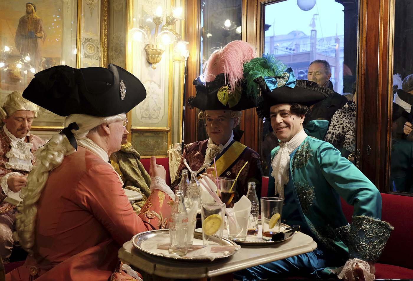 Revellers sit at the Caffe Florian coffee shop in Saint Mark's Square during the Venice Carnival, Italy January 31, 2016. REUTERS/Manuel Silvestri
