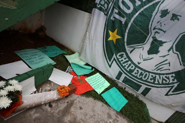 Flowers and messages are seen next a Chapecoense soccer team flag in tribute to their players in front of the Arena Conda stadium in Chapeco, Brazil, November 29, 2016. REUTERS/Paulo Whitaker