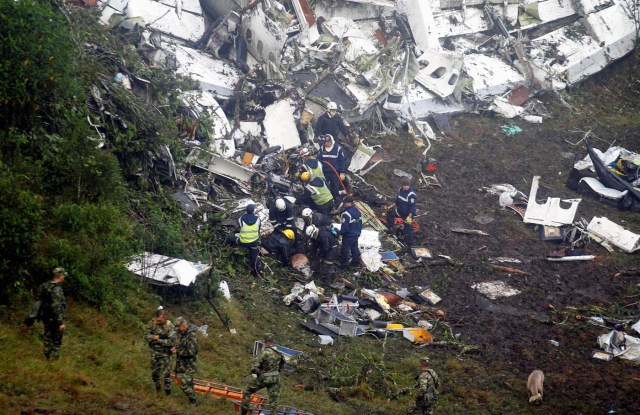 ATTENTION EDITORS - VISUAL COVERAGE OF SCENES OF INJURY OR DEATHRescue crew work in the wreckage from a plane that crashed into Colombian jungle with Brazilian soccer team Chapecoense, seen near Medellin, Colombia, November 29, 2016. REUTERS/Fredy Builes TEMPLATE OUT