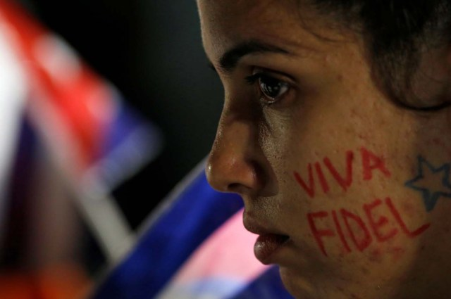 "A woman with the writing ""Fidel lives"" on her cheek participates in a massive tribute to Cuba's late President Fidel Castro on Revolution Square in Havana, Cuba, November 29, 2016. REUTERS/Stringer EDITORIAL USE ONLY. NO RESALES. NO ARCHIVE TPX IMAGES OF THE DAY"