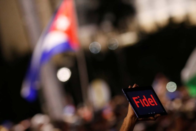 A man holds a tablet during a massive tribute to Cuba's late President Fidel Castro on Revolution Square in Havana, Cuba, November 29, 2016. REUTERS/Stringer EDITORIAL USE ONLY. NO RESALES. NO ARCHIVE