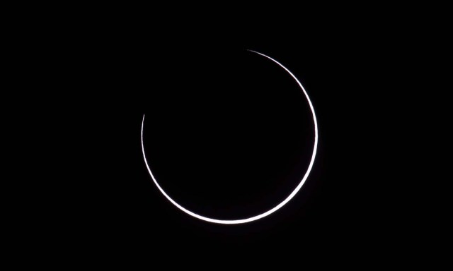 "Picture taken on February 26, 2017 showing the moon moving to cover the sun for an annular solar eclipse, as seen from the Estancia El Muster, near Sarmiento, Chubut province, 1600 km south of Buenos Aires, Argentina, on February 26, 2017. Stargazers applauded as they were plunged into darkness Sunday when the moon passed in front of the sun in a spectacular ""ring of fire"" eclipse. / AFP PHOTO / ALEJANDRO PAGNI"