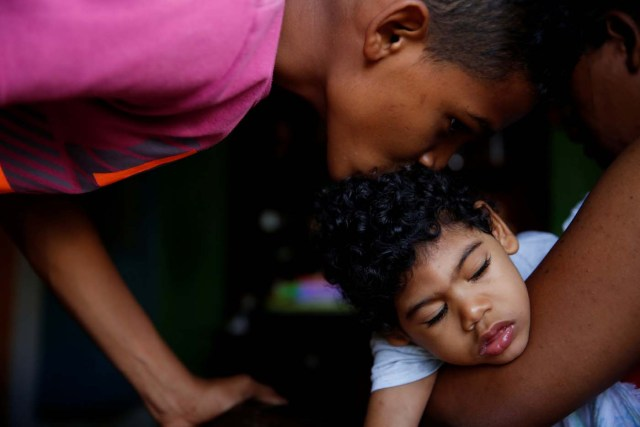 """Isai Rocha (L), 14, kisses his brother Kaleth Heredia, 2, neurological patient being treated with anticonvulsants, before going out, at their house in Caracas, Venezuela January 31, 2017. REUTERS/Carlos Garcia Rawlins SEARCH """"EPILEPSY CARACAS"""" FOR THIS STORY. SEARCH """"WIDER IMAGE"""" FOR ALL STORIES."""