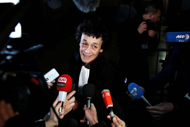 """Isabelle Coutant-Peyre, lawyer and wife of Ilich Ramirez Sanchez, known as """"Carlos the Jackal"""", talks to journalists at the courthouse before the opening of the Carlos' trial in Paris, France March 13, 2017. Carlos the Jackal is appearing in a Paris court for a deadly 1974 attack at a shopping arcade in the French capital, a trial that victims' families have been awaiting for decades. REUTERS/Benoit Tessier"""